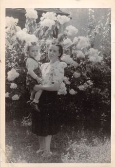 Black and White Vintage Snapshot Photograph Mom Holding Girl Flowers 1950's