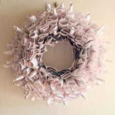 Magazine Wreath:     Not sure what to do with old issues of This Old House? Take your old magazines, books, and newspapers and make one of these. Get this look by cutting stacks of sheets that are the same size and carefully rolling them into cylinders of equivalent diameter. Pin cylinders as shown to a foam form, or loop and twist extra-long cylinders around a wire frame.    Shown: Romance Book Wreath; About $25; Etsy