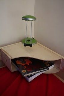 "A bunk bed ""bedside"" table made of a wooden magazine holder"