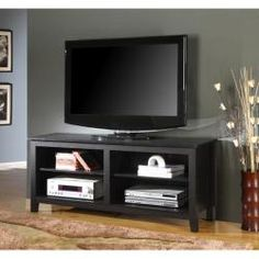 @Overstock.com - Black Wood 58-inch TV Stand - Style and function combine to give this contemporary wood TV console a striking appearance. The design creates a classy, modern look crafted from high-grade MDF and durable laminate.  http://www.overstock.com/Home-Garden/Black-Wood-58-inch-TV-Stand/6622576/product.html?CID=214117 $199.99