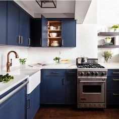Navy blue is a classic color that is both timeless and sophisticated. A relative of black, navy adds just a hint of mystery and intrigue that isn't found in its much-darker cousin. Learn all the perks of navy cabinets in our latest blog!  #navybluekitchencabinets #navycabinets #navybluebathroom #navybluekitchen #navykitchenisland #navykitchendecor #navybathroomideas #navybathroomvanity Blue Kitchens, Kitchen Cabinets In Bathroom, Shaker Kitchen Cabinets, Cabinet, Navy Cabinets, Kitchen Decor, Farmhouse Style Kitchen, Diy Kitchen Backsplash, Kitchen Design