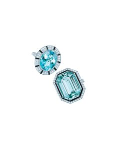 Tiffany diamond and gemstone rings with diamond and black onyx settings in platinum (top): oval cuprian elbaite tourmaline, emerald-cut green tourmaline.
