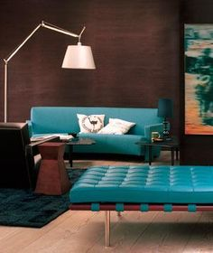 Furniture With large jewel-tone pieces, think texture. Rich colors have even more impact in reflective fabrics, such as velvet and silk. Dark jewel tones are also fantastic in leather—and a playful departure from traditional brown. Here, a turquoise sofa pops against chocolate-brown walls.