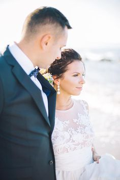 Jurgita, you're as bright as the sun. Loving the lace #bridaldress, perfect for an ethereal September bride!  #beautifulbride #realwedding MOMENTS Weddings & Events #weddinggown #weddinginCrete