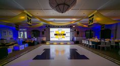 Go Blue! Matty's University of Michigan blue and yellow themed Wolverines party scored big among guests. No detail was overlooked between the sports lounge, press conference table, and scoreboard. The Tamarack Country Club was completely transformed into A Michigan Football Stadium. The X-Quisite team had such a great time designing this fun Bar Mitzvah! #barmitzvah #universityofmichigan #football