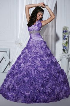 The ultimate rosette ball gown with ruched taffeta. A sequin belt and a one shoulder rosette add romance to the dress.