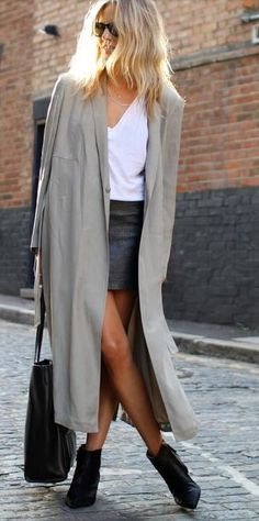 Fall style   Grey trench coat over white top and a black leather skirt, boots…