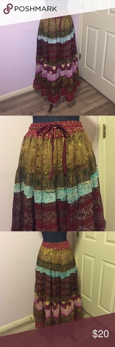 Gypsy skirt Glamorous glittery gypsy skirt!  Very unique, has a stretchy waist band with a tie. One size fits all. Gently worn. Great look for music festivals! Skirts Maxi
