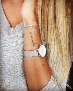 50 Tattoo Ideas That Are Simple, But Stunning is part of Sunflower tattoos Small Daisies - Thinking of getting inked Start small! Consider these tiny, simpler, and supercute tattoo ideas—that won't make your mom cry Small Name Tattoo, Name Tattoos For Moms, Baby Name Tattoos, Mommy Tattoos, Tattoos With Kids Names, Mini Tattoos, Cute Tattoos, Beautiful Tattoos, Body Art Tattoos