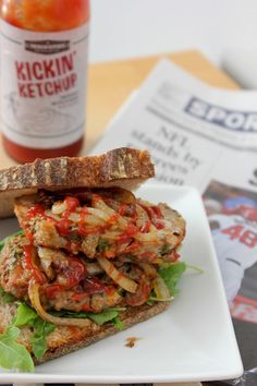 Kickin' Konfetti Meatloaf~ Shown served on Whole Grain Sourdough bread,  caramelized onion, arugula, and drizzled with Kickin' Ketchup.