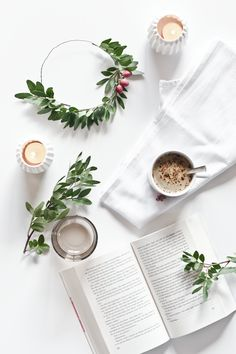 White Decoration with coffee, candle and a wreath.