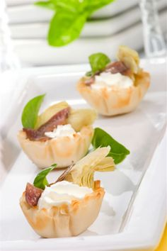 This cold appetizer recipe takes mere minutes to put together but these cute filo shells with their colorful filling is sure to make a popular appetizer. Easy party appetizers do not actually get much easier than this one and, if you are in a rush, these filled filo shells are ideal because you can make them so fast.