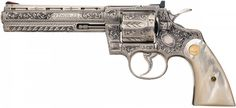 Cased Custom Engraved .357 Magnum Colt Python Double Action Revolver with Pearl Grips. What a gun.