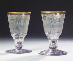 An important and very rare set of two Silesian engraved Judaica topographical gilt monogrammed matrimonial faceted goblets