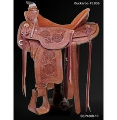 Buckaroo saddle shown with desert rose/waffle tooling in chestnut with rear cinch.Optional breast collar, headstall and saddlebag sold separately.