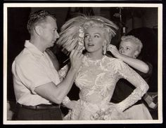 "Snyder applies makeup to Monroe on the set of 1953's ""Gentlemen Prefer Blondes."""