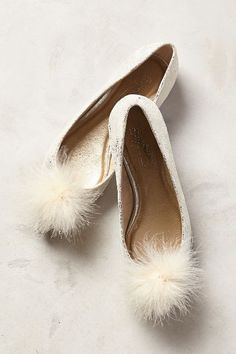 Love the pom poms on these darling flats!