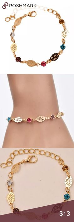 """HP 1/12Gemstone & Leaf Bracelet Host Pick Best In Boutiques Delicate design. Multicolored gemstones and intricate leaves are joined in this romantic link bracelet. Gold plated. Primary colors are gold, (blue) topaz, and citrine (yellow). Approximately 8"""" long. Please ask if you have questions. Jewelry Bracelets"""