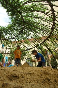 a sandpit enclosed by living willow to provide natural shade through the summer