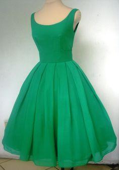 An emerald boat neck pleated skirt cocktail dress custom.
