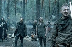 Kingdom of Heaven (movie) Godfrey of Ibelin (Liam Neeson, foreground) is alerted to a possible attack, as Hospitaler (David Thewlis, left), Balian (Orlando Bloom) and Odo (Jouko Ahola) await his instructions.