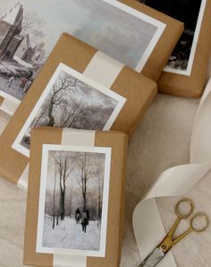 Find some beautiful winterscapes and affix them to kraft paper with satin ribbon and glue for an arc... - Design Sponge