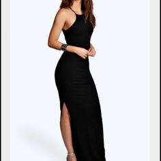 """Black side split strapless bodycon maxi dress Brand new with tags. Fits amazing and I would keep it but it's a little short on me. I'm about 5'6/5'7 and an Xs/S. Would look maxi on 5""""4 and shorter. Very stretchy and can fit a size Xs to a M. Boohoo Dresses Maxi"""