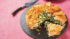 Skinny Spanakopita. This savory Greek-style pastry is a great way to incorporate more spinach in your   diet. We use a whole-grain phyllo dough brushed with olive oil and feta cheese to add a creamy, salty kick. If you're sensitive to gluten, see the tip at the bottom of the recipe to easily adapt it. For a prettier presentation, we simply take the phyllo and crumble it over the top of the pie before baking it.