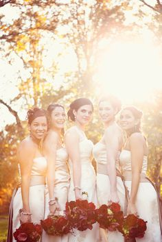 champagne bridesmaid dresses with cranberry bouquets