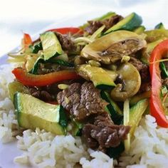 Asian Beef with Snow Peas - Allrecipes.com.  Can boost asian flavors with 2 to 3 teaspoons toasted sesame oil at very end.  Garnish with crushed peanuts, green onions or a little cilantro