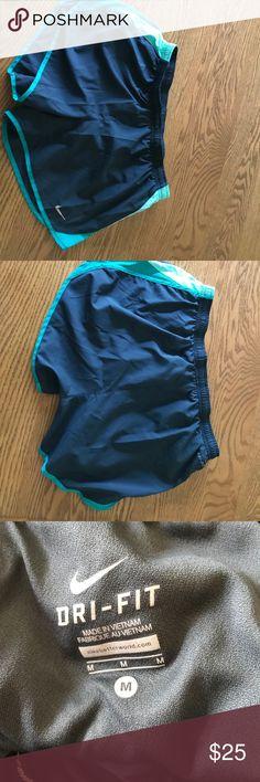 Nike Dri Fit shorts size medium Grey and teal Dri Fit Nike shorts, hardly worn, great condition! Nike Shorts