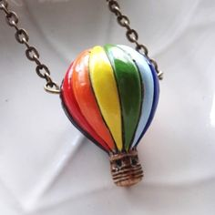 Hey, I found this really awesome Etsy listing at http://www.etsy.com/listing/57865370/hot-air-balloon-necklace-ceramic-bead-on