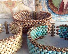 ~ Turquoise Peyote Chic ~  This piece has such an organic feel! Some days you want to wear something country and rustic ...but with making a statement!! Wear with jeans and t-shirt combo or a simple sundress with sandals...Turquoise never goes out of style :) One and a half inches thick of turquoise-colored beads trimmed by an earthy brown trim to complement the rustic clasp ~ 10 rows of beautiful shades of blues and greens that are touched with hints of brown in the beads that make a…