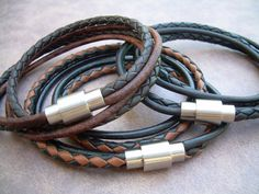 The essential Fashion Accessory... a rich and tasteful leather bracelet. This bracelet style features Double Strands of Fine Imported Quality - 3mm leather cord and a strong- secure stainless steel magnetic closure clasp (3/4 in length) for easy on and off. All dyes used in our leather are certified 100% Lead-Free and meet all requirements of the German Goods Ordinance, REACH (European Union), RoSH (U.K.), and CPSIA (U.S.) which require consumer goods to be free of Lead, AZO's and…