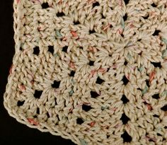 My hand crocheted cotton dishcloths are long lasting and hard working. This dish cloth is beige with flecks of blue and pink.At about 9 inches across it fits well in your hands and is big enough for all kinds of cleaning chores.CC0010