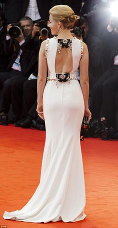 Intricate: The dress appeared simple from the front, but as she turned, the actress reveal...