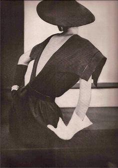 1950 Harper's Bazaar.Christian Dior .The perfect short black dress with the sailor collar hind-side-fore and a deep decolletage in back