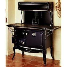Waterford Stanley Wood Cook Stove - Limited Quantities Available - Today Pin Wood Burning Cook Stove, Wood Stove Cooking, Kitchen Stove, Cooking Lamb, Cooking Pasta, Kitchen Cabinets, Kitchen Appliances, Antique Wood Stove, How To Antique Wood