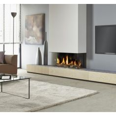 De #Dru Metro 100XT/3-41 RCH #gashaard biedt een breed, panoramisch vuurzicht en vormt samen de uitkomst voor hen die een breed vuur willen combineren met een fantastisch vuurzicht van meerdere zijden. Een ultieme blikvanger dus, die ongekende sfeer zal brengen in uw woonkamer. #Fireplace #Fireplaces #Kampen #Interieur