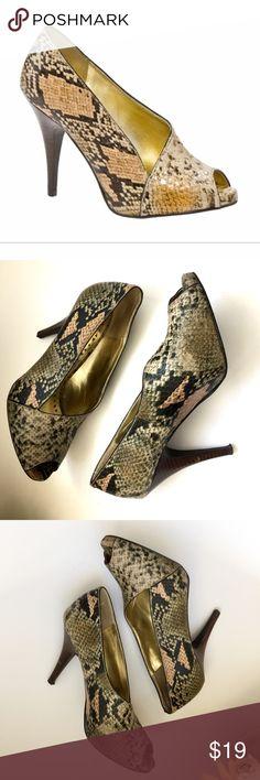 BCBG Paris Ilta size 7.5 heels BCBG Paris Ilta snakeskin print perp toe size 7.5.  Please see last pic, nick in heels.   Posh Ambassador • Smoke and Pet Free Home • Fast Shipping! BCBG Shoes Heels