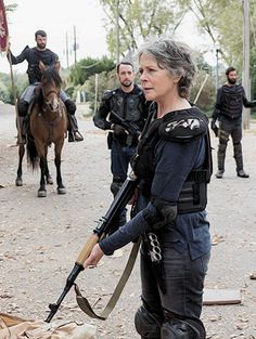 "Carol (Melissa McBride) fights with The Kingdom. Our grey-haired queen bitch is baaaack! | Season 7:Episode 16 - ""The First Day of the Rest of Your Life"""
