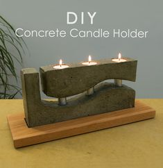 Unique concrete candle holder with a wooden base.    Although this candle holder has an intricate shape, it can be easily achieved with a simple technique for casting concrete.  There's no limit to the shape variations you can achieve with this method of casting concrete.