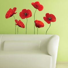 Putting these on a pale coral wall above a red sofa.