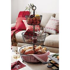 "Tiered display and serving baskets are handcrafted of iron wire in a distinctive rustic ""weave"" and finished in a multistep process of zinc plating, dipping and rubbing to create the beautiful, dark antiqued patina.<br /><br /><NEWTAG/><ul><li>100% iron</li><li>Antique zinc finish</li><li>Foodsafe</li><li>Hand made</li><li>Clean with a damp cloth</li><li>Made in India</li></ul>"