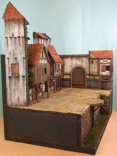 Behind the scenes- Making a Dungeons and Dragons town backdrop The release of two Baldur's Gate box sets, it gives me a great opportunity to show you the theory and evolution of creating a box cover backdrop. Fantasy Village, Fantasy Town, 40k Terrain, Wargaming Terrain, Medieval Houses, Medieval Town, Chateau Fort Jouet, Tabletop, City Backdrop