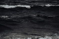 Black and white shot of sea waves with ocean foam in Iceland