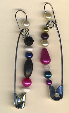 Black, white, gold and pink beads on safety pins with kidney wire findings, lightweight and eye catching $15