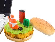 Chicken Burger USB Hub This tasty looking thing is the latest addition to the never ending stream of weird computer accessories. It's a USB compliant hub designed to look like a chicken burger. Usb Gadgets, Geek Gadgets, Cool Gadgets, Usb Hub, Chicken Sandwich, Food Inspiration, Geek Stuff, Fun Stuff, Tasty