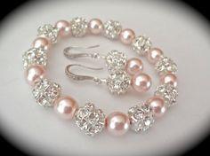 Natasha. Stunning, love the rose coloured pearls.                                                                                                                                                                                 More