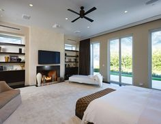 Great bedroom, I love the fireplace, and the windows and walk out door, this would be very nice and romantic.